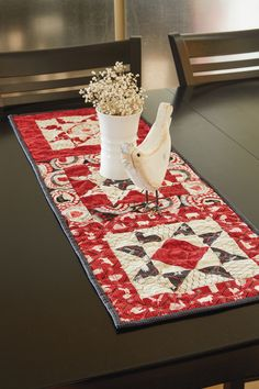 FARM TABLE by Angie Milligan: This fat quarter-friendly project made up in fabrics by Windham makes a pretty centerpiece. A traditional star pattern in red, cream and black, it's fun and fast to stitch.