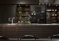 Form 1 / Smoked oak adds a masculine feel to this bespoke kitchen in Stockholm. Kitchen Dinning, New Kitchen, Kitchen Decor, Bespoke Kitchens, Kitchen Cabinetry, Minimalist Interior, Florida Home, Cozy Living, Wall Oven