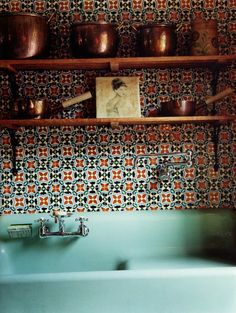 I am in LOVE with this mod kitchen! From the turquoise sink to the retro wallpaper, and the copper pots!! Yum!