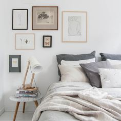 Picture gallery above bed, mismatched frames