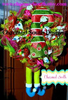 Ruffle deco mesh wreath complete with tons of ribbons, elf hat, and elf legs. Whimsical and very full wreath.  Follow us at www.charmedsouth.etsy.com