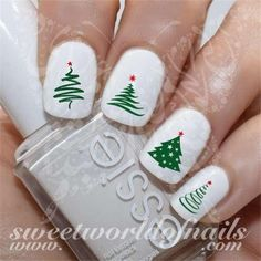 Here are some Christmas nail art designs to get you in the mood for the holiday season. Now, without further ado, read on to 40 elegant white nail designs for Christmas. There's a nail look to help you celebrate in style. Christmas Tree Nail Art, Cute Christmas Nails, Christmas Nail Art Designs, Xmas Nails, Holiday Nails, Christmas Decals, Silver Christmas, Holiday Mood, Christmas Design