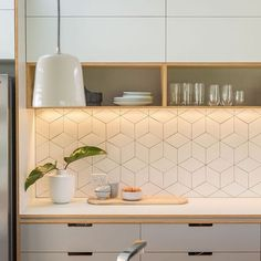 A kitchen full of white tiles may not necessarily sound inspiring, but with a wide range of tile shapes and styles available you really can create a unique look. This geometric design really enhances the look of this all-white kitchen. Buy your oak cabinets and painted frontals now, from Solid Wood Kitchen Cabinets: http://www.solidwoodkitchencabinets.co.uk/