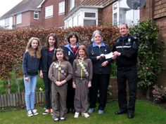 Rye Police has donated £200 to Westfield Brownies and Guides to with the continued running of the group which is very popular and well attended by local children.  The donation comes from the Police Property Act Fund (PPAF), made up of monies received by the police from property confiscated by order of the court and then sold.  PCSO Richard Perchard is pictured handing over the cheque. Cheque, Rye, Charity, Brownies, Acting, Police, Popular, Running, Group