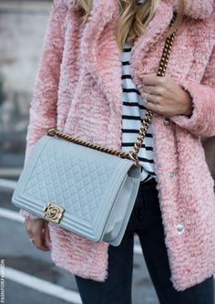 This pink fuzzy jacket is the chic solution to staying warm this fall.