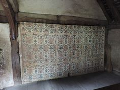 Painted wall cloth in bedroom at the Weald and Downland Museum