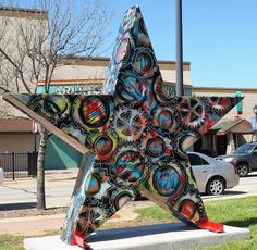 """This """"Stars of Texas"""" highly complex work pictures an intricate and colorful intermingling of gears. It's titled """"Business"""" by artist Danielle Zamagni and resides in the Vandergriff Building courtyard just west of Grease Monkey overlooking the Arlington Music Hall, 200 block of North Mesquite Street."""