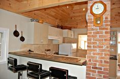 Love the exposed brick chimney in this St.Catharines home