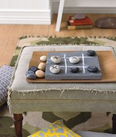 Make a Tic-tac-toe Game for kids out of coloured pebbles, a paver or tile and chalk. Or paint the game on a stepping stone or tree stump for outdoor play. If you don't have pebbles, children can pick fresh leaves, find pods, use large bean seeds or other nature items for each new game.   The Micro Gardener