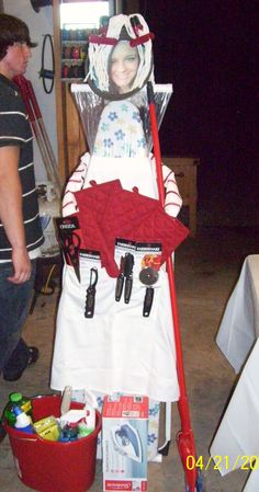 Made this for my new daughter-in-law. Everything is usable in their home. Ironing board, cake or pizza pan for head, mop for hair, chip clips for barettes, dish towels for arms, oven mitts for hands. an apron and stuffed kitchen tools in her pockets. It was a big hit.
