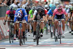 Giro d'Italia 2014 - Stage 7 - Nacer Bouhanni (FDJ) throws his bike at the finish