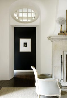 Roses and Rust: Dramatic...love the contrast in wall color from the main room into the hallway.