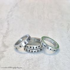 Fill your fingers with DIY Stamped Stack Rings! http://icanmakemetalstampedjewelry.com/stamped-stacked-rings/ #makeitwithmadge #DIYJewelry #metalstampedjewelry