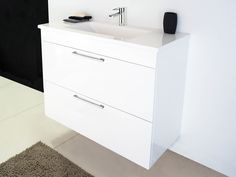 like the 900 wide (only 1 set draws). With semi submerged basin ...