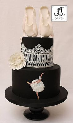 - Hand painted ballerina. with a 2d gum paste tutu. Cake lace. Gum paste peony and ballet shoes.