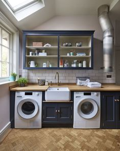 A stylish, on-trend utility room featuring warm brassware, open-fronted shelving and oak finishes. Handmade Kitchens, Custom Kitchens, Bespoke Kitchens, Luxury Kitchens, Laundry Chute, Laundry Room, Martin Moore Kitchens, Open Shelving Units, Kitchen Maker