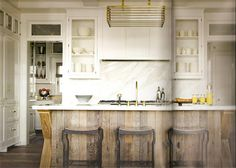 Rustic Chic: Reclaimed wood island & glass cabinetry...reclaimed wood bar + marble backsplash and creamy cabinets and industrial counter stools
