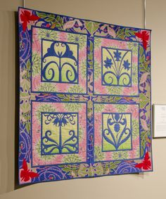 """Quilts of Jane Sassaman is currently on exhibit at The National Quilt Museum.  See fifteen of Jane's amazing quilts in this exhibit that will run through July 11, 2017.    The quilt in the picture is entitled, """"Pink Divas."""