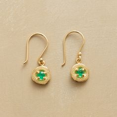 """DANGLING EMERALD EARRINGS--Set within fields of textured 14kt gold, Anne Sportun's emeralds reveal flashes of bright green as light dances across their facets. A handcrafted exclusive with French wires. 3/4""""L."""