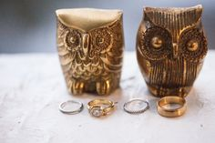 ring shot idea (gold owls) - Coral and Navy Wedding from Summer Street Photography - via heartloveweddings