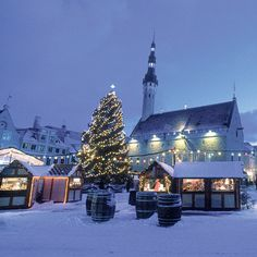 Snow-covered Market Stalls in Tallinn. Find this plus more great winter escape ideas at Redonline.co.uk