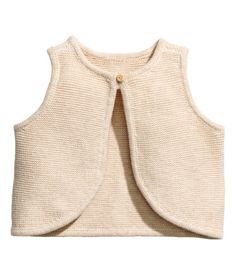 Light beige. BABY EXCLUSIVE/CONSCIOUS. Vest in soft, organic cotton knit fabric with a button at neckline.
