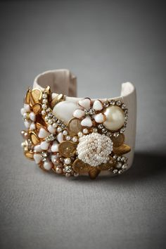 Vintage Jewelry cheap bracelet, fabric and bits of old jewelry, buttons or whatever catches your fancy. In fact, this is a great way to salvage jewelry like the odd earring you just couldn't bare to throw out. Jewelry Shop, Jewelry Accessories, Jewelry Design, Jewelry Making, Jewellery, Vintage Jewelry Crafts, Handmade Jewelry, Fabric Jewelry, Beaded Jewelry