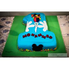 First Birthday Cake #cakedecorating #firstbirthdaycake #chocolatemudcake #ganache #fondant #colors #blue #white #green #red #black #balloons #gateauxoflove