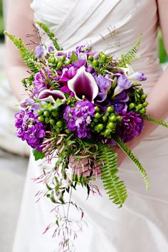 purple wedding bouquet; use peacock feathers instead of ferns