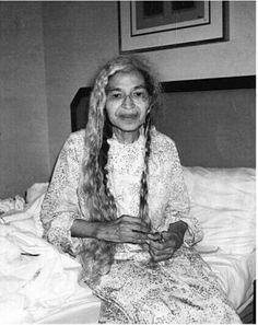 A rare picture of Rosa Parks taking her hair down before bed.