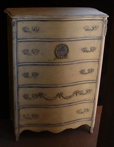 Yellow and ivory serpentine dresser; age uncertain.