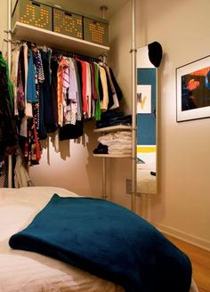 oh this, this is incredible. open closet, pipe closet, organized, kind of.