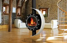 Poêle à bois aux lignes généreuses telles celles d'une cheminée incarnant la rencontre du Soleil et de la Lune pour votre plus grand plaisir et pour votre confort... Fabrication 100 % française !!!