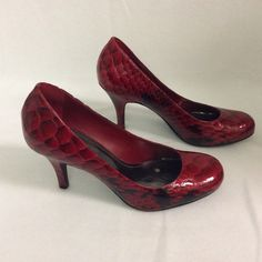 Gorgeous red shiny heels. Leather upper red shiny heels. High quality shoes. 3 1/2 inch heel. minor Nicks as shown in pictures. More pictures are available in a separate listing. Gianni Bini Shoes Heels