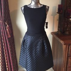 Cute Black dress American Living black dress. Size 6. Skirt portion of dress has cute black polka dot pattern with slight sparkle and material is 100% polyester. Top of dress is 95% polyester, 5% elastane. New with tags. American Living Dresses