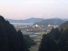 View of Sukumo and agricultural lands from the mountain trail heading up to Matsuo Pass, Ehime prefecture.