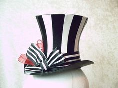 Top hat - the piecing allows for the curvature.