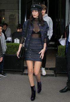 Bella Hadid wearing a belted skirt and denim shirt with hat | ASOS Fashion & Beauty Feed