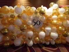 Gold and White organic wall - embellished with pops of confetti blast and custom printed perspex feature