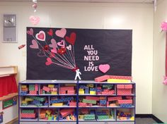 Erica, Jocelyn & Claudia did a great job using scrapbook paper for this Valentine's day board!