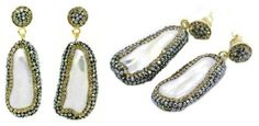 UPDATED JULy 7:  The earrings are by Soru Jewellery, the brand's Baroque Pearl Earrings in gold.