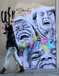 Children from different cultures laugh together in this street art poster by STMTS that celebrates unity and acceptance