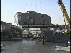 Sea Village Marina, Sea Tow Lifting floating home from the water  after ...