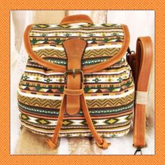 """Tribal Print Convertible Bag This Tribal Print convertible bag is canvas construction with faux leather trim. It can be used as a crossbody or backpack with adjustable straps with an easy conversion. 9"""" Tall X 8"""" Wide. #8B                                           Suggested User Top Rated Seller  Fast Shipper Bundle Feature  Pet/Smoke Free Home PayPal/Trades BEAUTY BUCKS: Buyer Reward Program Bags"""