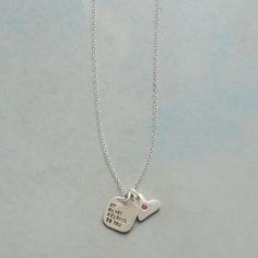 """ALL YOURS NECKLACE--A little love note reads """"my heart belongs to you"""" alongside a heart charm set with a tiny garnet on this 'All Yours' necklace. Sterling silver charms, chain and spring ring clasp. Handmade in USA. 18""""L."""