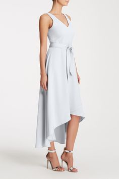 Emily is the perfect mid-length dress in our flowy, satin-back crepe. Features a flattering front V neckline and bra-friendly back. Detachable waist sash cinches in the waist while a full, cascading skirt with a high-low hem is perfect to dance in.