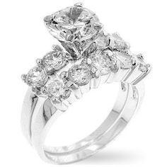 Wedding Ring Bridal Set Genuine Rhodium Plated Bridal Set with Prong Set Round Cut Clear Cubic Zirconia Between a Pair of Baguettes and Small Round Cut Clear Cubic Zirconia and a Second Band of Channe