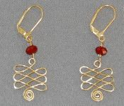 Wire earrings - Celtic Swirl Pattern  Something new to try with the Jig that I received from AnneMarie Hoffman!