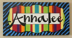 fun black and blue zebra print hand painted and personalized canvas for a girl's room.