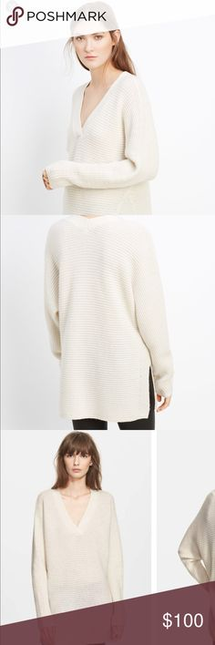 Vince Wool-Cashmere Traveling Rib Double V EUC. Some pilling. Extra long sleeves. Super cozy. Cute side slits add interest to the simple, but chic topper. Additional photos and details to come. Sold out online. Aside from being wrinkled, great condition. Worn only a handful of times. Very minor pilling but no other issues. Vince Sweaters